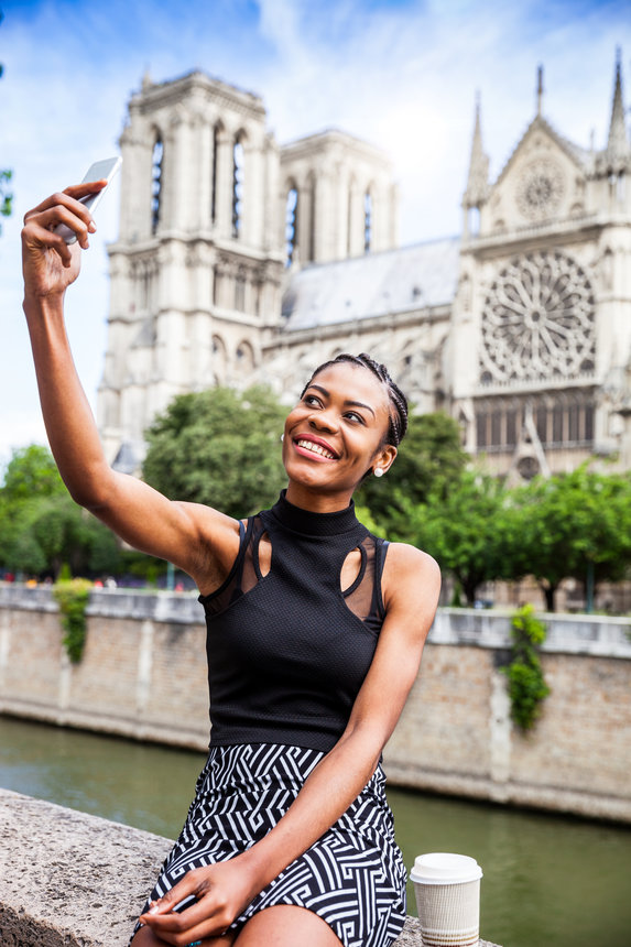 Tourist in Paris, selfie in Notre Dame
